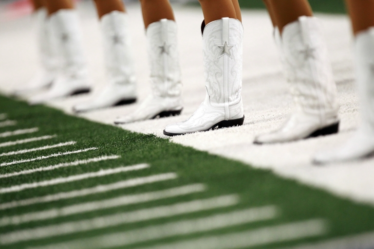 <p>The Dallas Cowboys cheerleaders stand on the sideline at Cowboys Stadium on Dec. 11, 2011. Employment in Dallas will return to pre-recession levels in 2012, a new report says.</p>