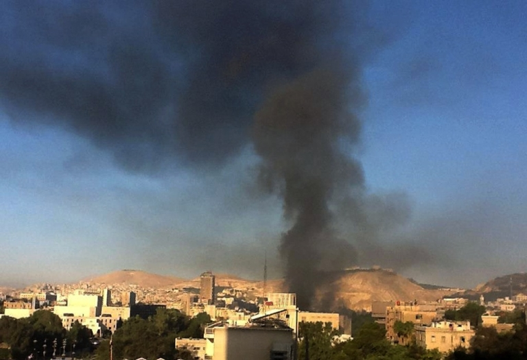 <p>Smoke rises from the site of an explosion in Damascus on Sept. 26, 2012. Syrian rebels struck the heart of Damascus early Wednesday, setting off twin explosions near the headquarters of the armed forces general staff, state media said.</p>