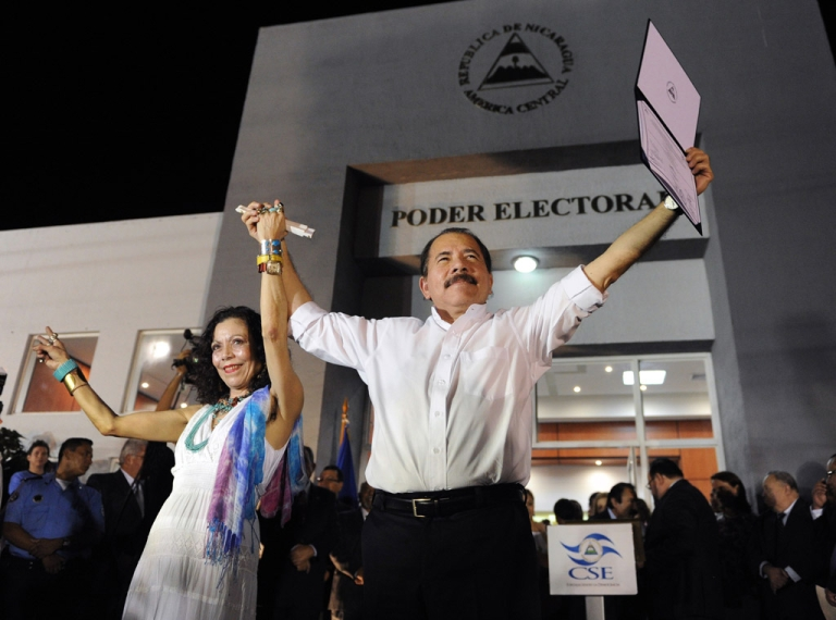 <p>Nicaraguan President Daniel Ortega celebrates with First Lady Rosario Murillo after receiving his credentials in Managua Monday, a day before his re-inauguration.</p>