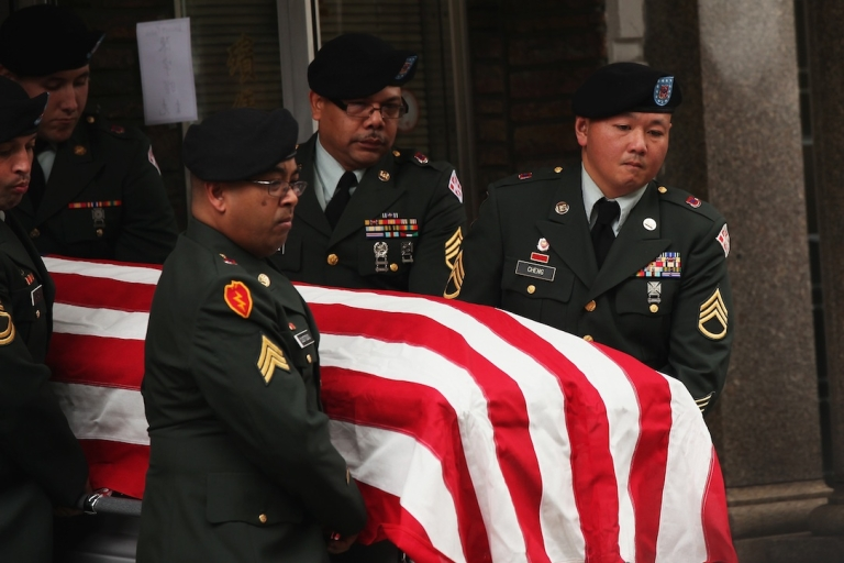 <p>Soldiers carry the casket of Army Pvt. Danny Chen in Chinatown on October 13, 2011 in New York City.</p>