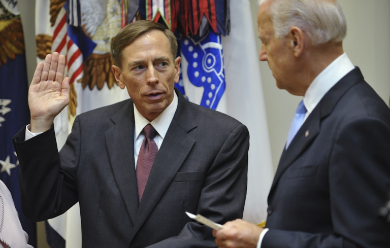 <p>General David Petraeus(L), former head of the allied forces in Afghanistan, takes the oath of office as the next director of the Central Intelligence Angency from US Vice President Joe Biden on September 6, 2011 during a ceremony at the Roosevelt Room of the White House in Washington, DC.</p>