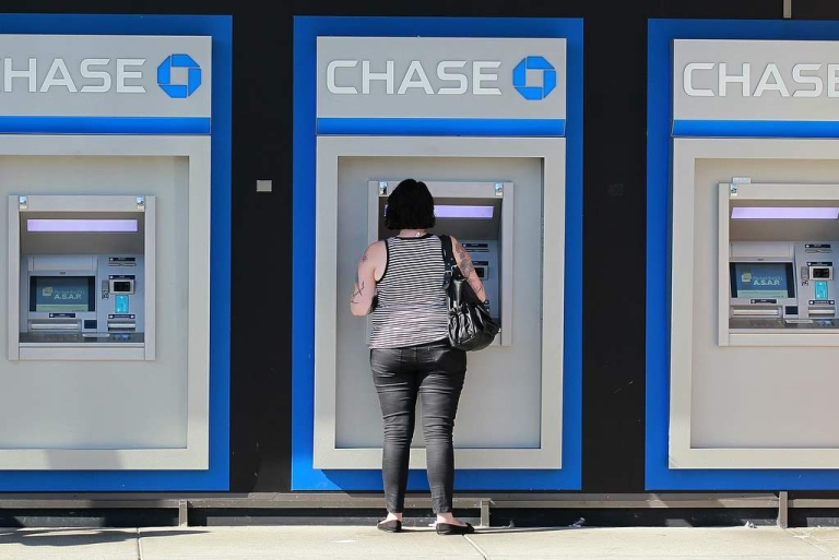 <p>A customer uses an ATM outside of a Chase bank office on October 13, 2011 in Oakland, California.</p>