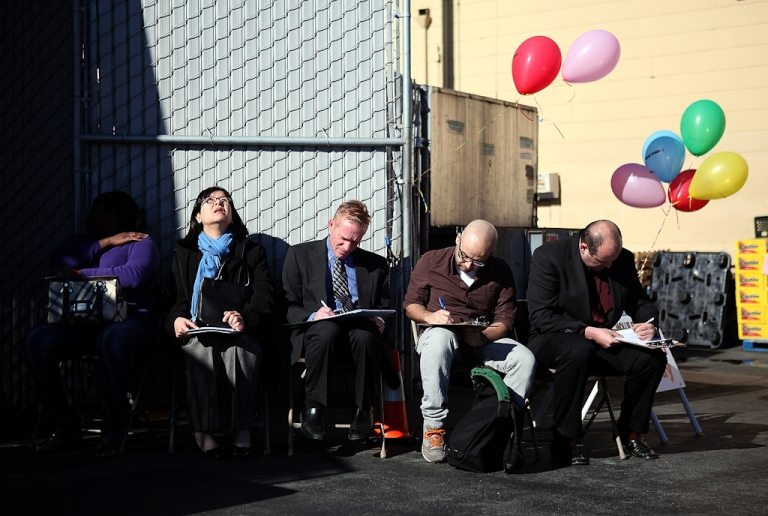 <p>The debt crisis may worsen the U.S. unemployment rate. Job seekers fill out applications for employment during a job fair for San Francisco Bay Area grocery store chain Mollie Stone's Market on February 9, 2011 in San Francisco, California.</p>