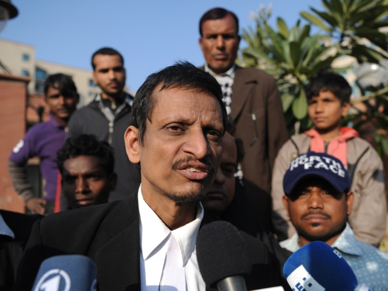 <p>Indian lawyer M.L. Sharma, who represents two of the five adult defendants on trial for the gang-rape of a student, speaks with the media outside the Saket District Court in New Delhi on Jan. 10, 2013.</p>