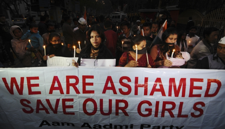 <p>Indian protestors march behind a banner as they take part in a candlelight procession in Guwahati on December 29, 2012, after the death of a gang rape victim from the Indian capital New Delhi. Indian leaders appealed for calm and security forces headed off fresh unrest by turning New Delhi into a fortress after a student who was savagely gang-raped died in a Singapore hospital. Police threw a ring of steel around the centre of the Indian capital after news of the 23-year-old medical student's death was broken in the early hours by the Singapore hospital that had been treating her for the last two days.</p>