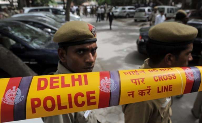 <p>Indian police officials stand guard at the site of an explosion outside Delhi High Court in New Delhi on May 25, 2011. A low-intensity bomb exploded in a parking lot outside the busy Delhi High Court triggering panic, yet no injuries were reported, according to the Press Trust of India (PTI).</p>