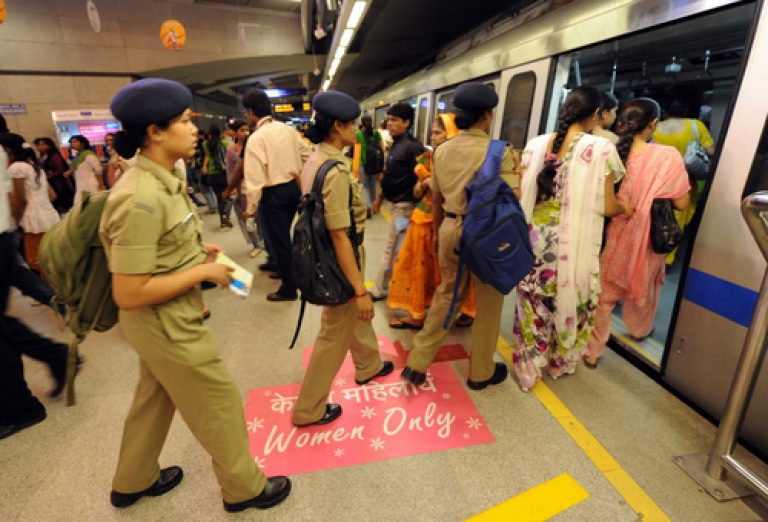 <p>Female commuters board a women-only coach at a Delhi Metro train station in New Delhi on October 2, 2010.</p>