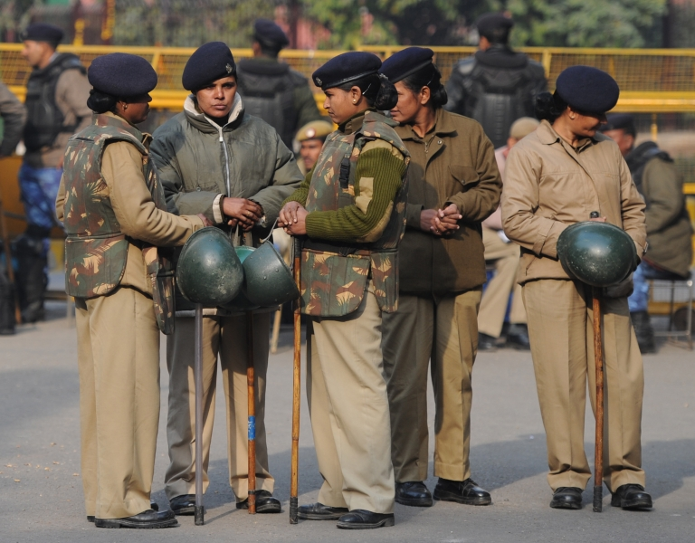 <p>Indian women police stand guard at Jantar Mantar during a protest against a gang rape in New Delhi on January 6, 2013. Three of the five men accused of raping and attempting to murder the victim will plead not guilty, their lawyer said on January 8, 2013.</p>