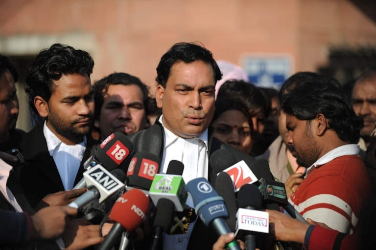 <p>Indian lawyer Ajay Prakash Singh (C), who represents defendants Akshay Thakur and Vinay Sharma who are on trial for the gang-rape of a student, speaks with the media outside the Saket District Court in New Delhi on January 10 ,2013. A lawyer for the defendants in the New Delhi gang-rape case accused police on January 10 of beating confessions out of them as they appeared for their second court appearance.</p>