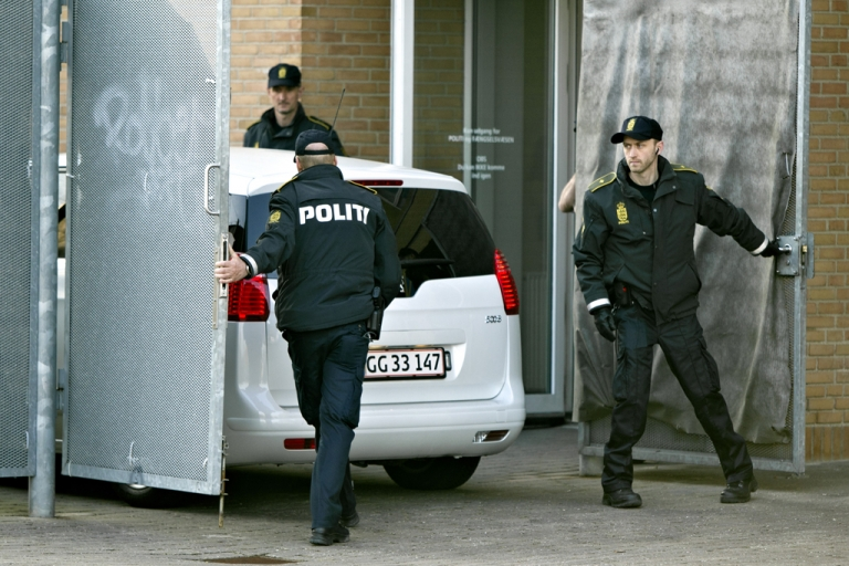 <p>Terror suspects arrive on April 13, 2012 in a police car at the Glostrup courthouse in Copenhagen for their trial over a suspected plot to massacre the staff of a newspaper that first published controversial cartoons of the Prophet Mohammed. Police announced on April 27, 2012 that three others were arrested in a separate terror plot.</p>