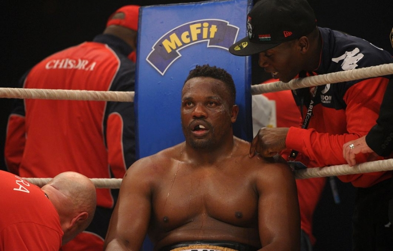 <p>British boxer Dereck Chisora sits in his corner during his fight against Ukrainian WBC World Champion Vitali Klitschko in Munich on Saturday, February 18, 2012.</p>