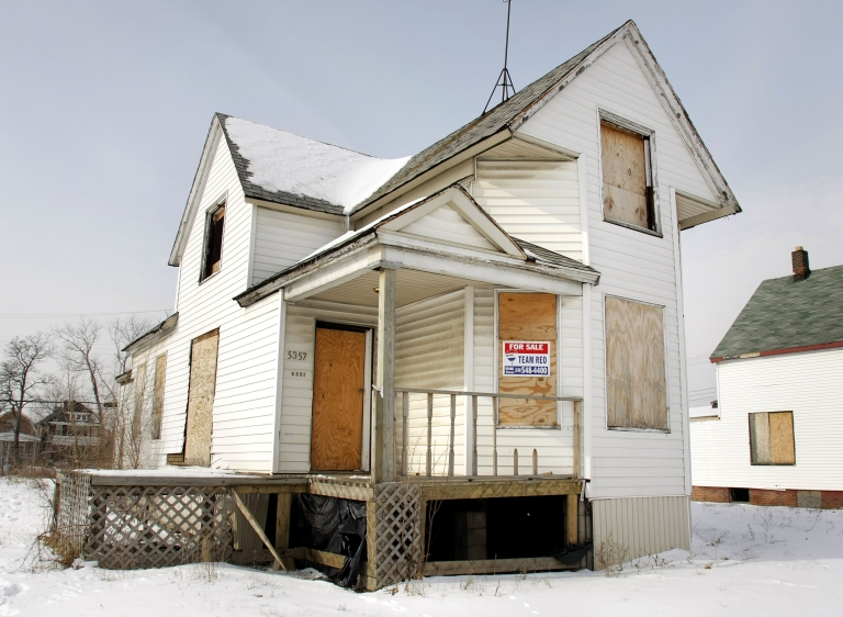 <p>A boarded up house sits for sale Feb. 14, 2008 in Detroit, Michigan.</p>