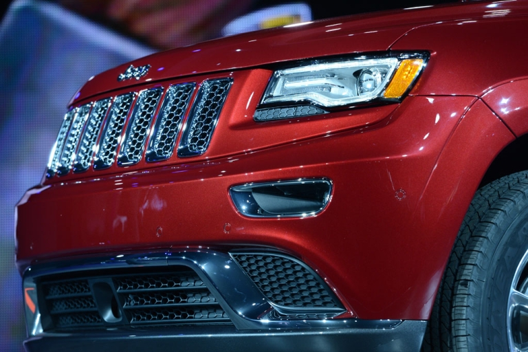 <p>Detail on the 2014 Jeep Grand Cherokee as it is introduced at the 2013 North American International Auto Show in Detroit, Michigan, January 14, 2013.</p>