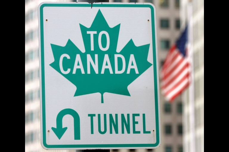 <p>A sign directs drivers to the border crossing at the Detroit/Windsor Tunnel in Detroit, Michigan. The tunnel was shut down on July 12, 2012, after an anonymous phone call warned of a bomb in the tunnel.</p>