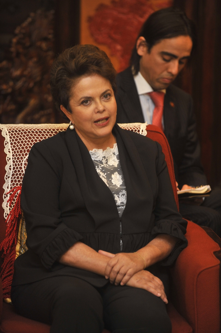 <p>Brazilian President Dilma Rousseff talks with Chinese premier Wen Jiabao on a recent visit to China.</p>