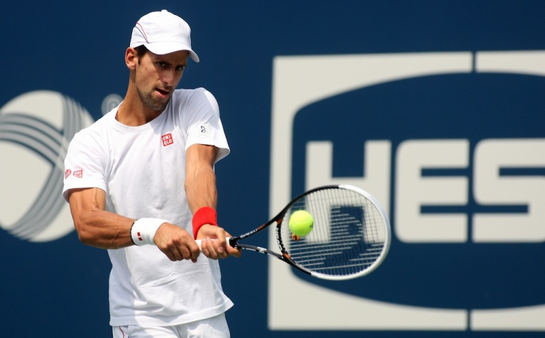 <p>Novak Djokovic hits a shot while practicing before to the start of the 2012 U.S. Open at the USTA Billie Jean King National Tennis Center on Aug. 24, 2012, in Queens.</p>