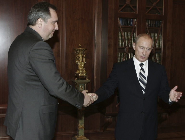 <p>On Jan. 26, 2008, Russian President Vladimir Putin (R) shook hands with Dmitry Rogozin, then serving as Russia's ambassador to NATO before becoming deputy prime minister.</p>