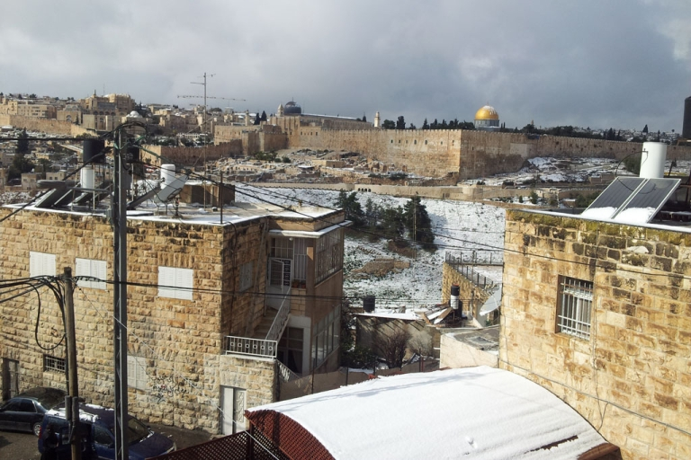 <p>Jerusalem's Dome of the Rock and the Old City covered with snow on January 10, 2013.</p>