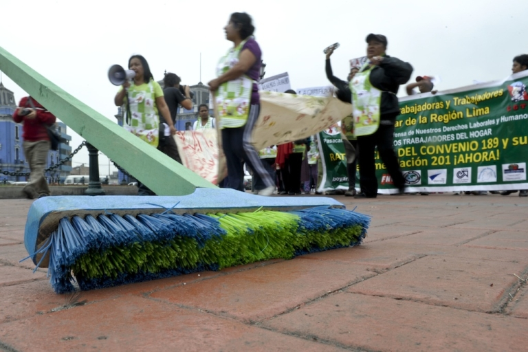 <p>A group of domestic workers take part in a protest demanding for better working conditions in Lima on June 15, 2012.</p>