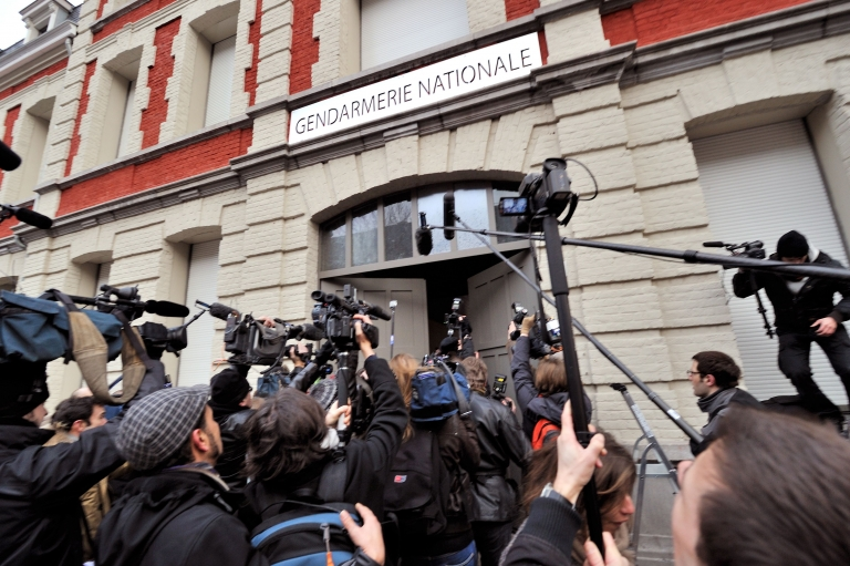 <p>Members of the press film and photograph former IMF chief Dominique Strauss-Kahn arriving at a police station in Lille, northern France on Tuesday morning.</p>