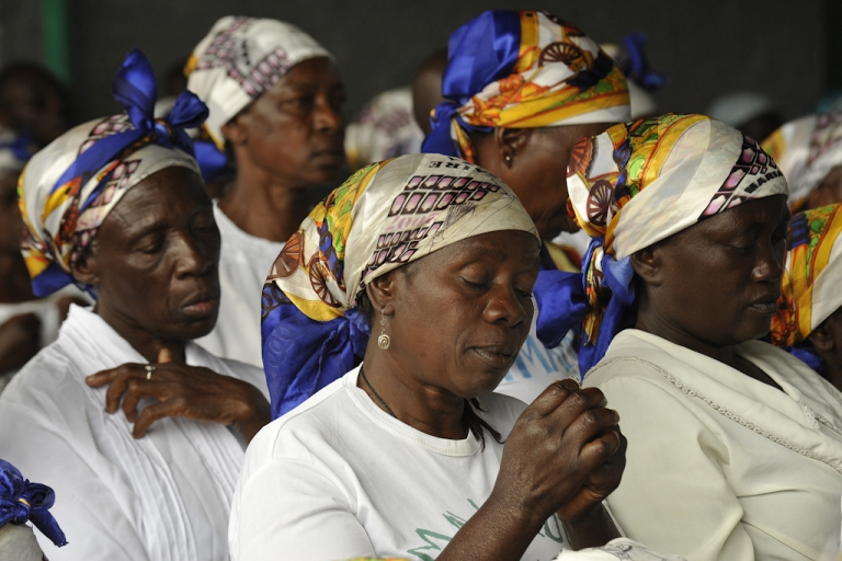 <p>Congolese 'Mama wa Amani' (women of peace) pray for peaceful elections at the Ijize church in Goma on November 27, 2011 on the eve of ahead of presidential and legislative elections. Tensions flared on the eve of Democratic Republic of Congo elections as opposition leader Etienne Tshisekedi called a rally in the capital despite a ban on gatherings followed deadly violence. The polls are only the second here since back-to-back wars from 1996 to 2003, the scars of which are still fresh.</p>