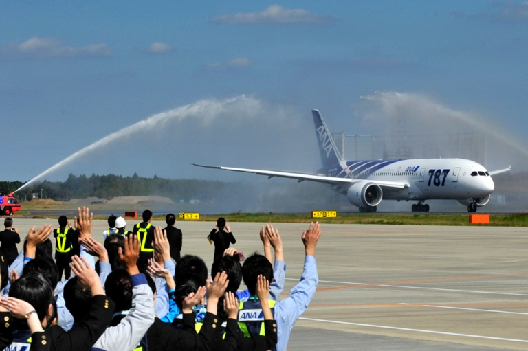 <p>All Nippon Airways (ANA) ground crew wave goodbye to the company's first commercial flight of a Boeing 787 Dreamliner on its departure for Hong Kong on October 26, 2011 at Narita Airport in Chiba prefecture, suburban Tokyo.</p>