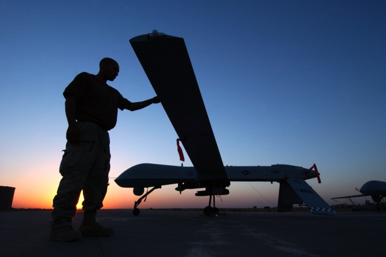 <p>A crew chief completes a post flight inspection of a Predator drone on Sept. 15, 2004 at Balad Air Base, Iraq.</p>