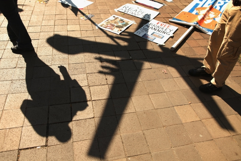 <p>A model of a military drone casts a shadow on the ground during a protest Oct. 6, 2011 in Washington, DC.</p>