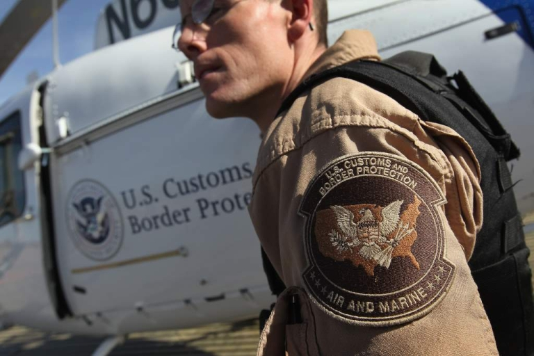 <p>Air interdiction agent Jake Linde from the U.S. Office of Air and Marine boards his helicopter to fly over the Sonoran Desert while searching for illegal immigrants and drug smugglers on December 9, 2010 in the Tohono O'odham Reservation, Arizona.</p>