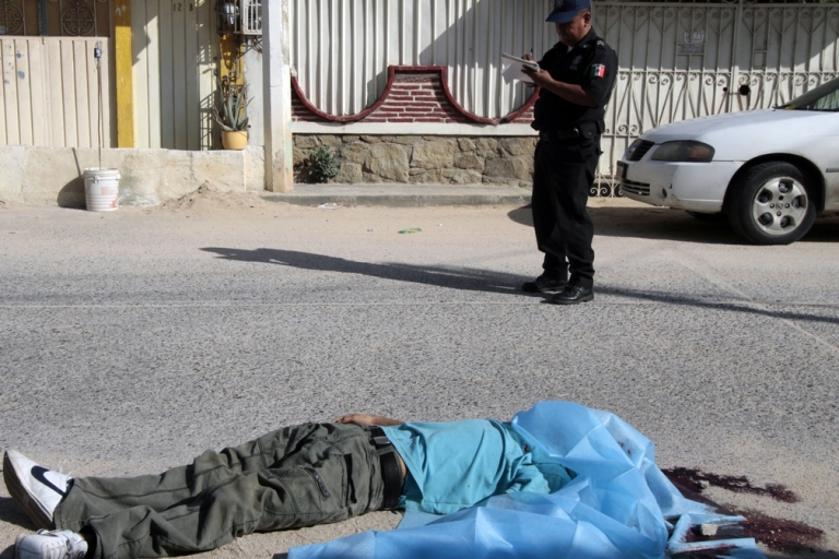 <p>An estimated 40,000 people have died in Calderon's war on drugs.</p>