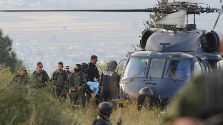 <p>Members of the Mexican army and Federal Police remove the body of a victim following a helicopter crash that killed Mexican Interior Secretary Francisco Blake Mora on Nov 11 in Tlamanalco, Mexico state.</p>