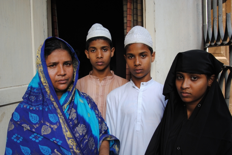 <p>The family of Aminul Islam at their home in Kaliakoir, Bangladesh. Islam was found murdered, his body tortured, on April 6, 2012.</p>