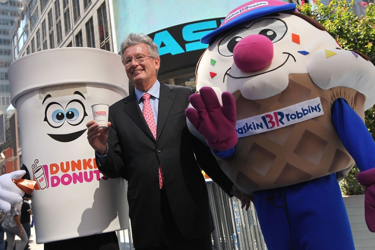<p>Nigel Travis, chief executive officer and president of Dunkin' Brands Group Inc., celebrates their initial public offering outside the NASDAQ MarketSite on July 27, 2011, in New York City, N.Y. The company plans to open over 300 new restaurants in the US in 2013, including the first public Dunkin' Donuts in California.</p>