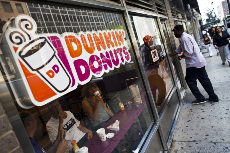 <p>A man enters a Dunkin' Donuts store in New York.</p>