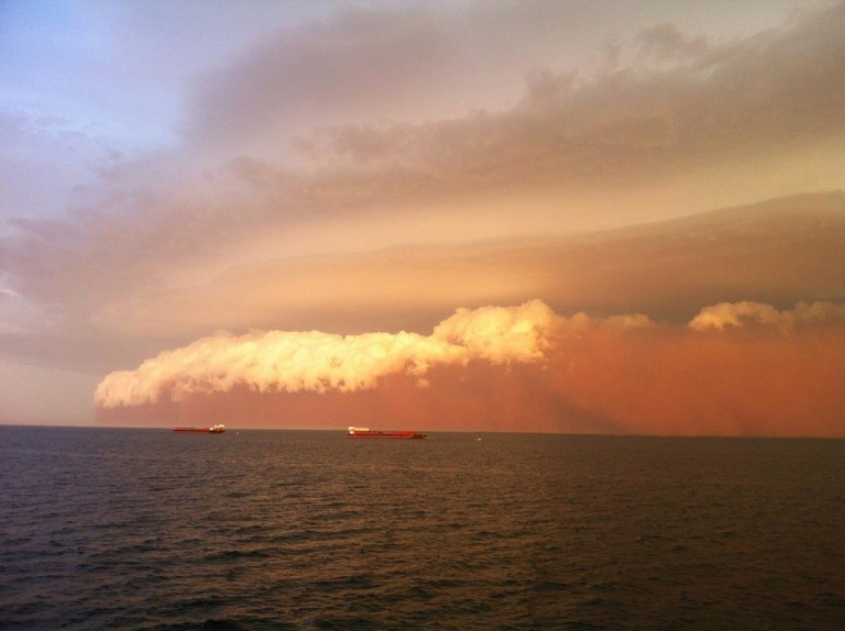<p>A massive dust storm collided with the Australian coast Wednesday, covering everything in its path in red sand.</p>