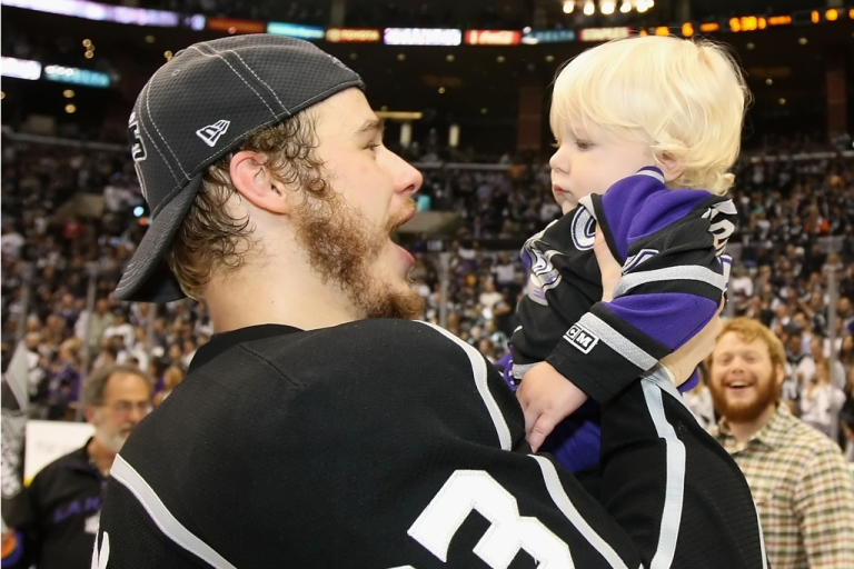 <p>Dustin Brown of the Los Angeles Kings celebrates with his one year-old son, Cooper, after defeating the New Jersey Devils to win the Stanley Cup on June 11, 2012 in Los Angeles.</p>