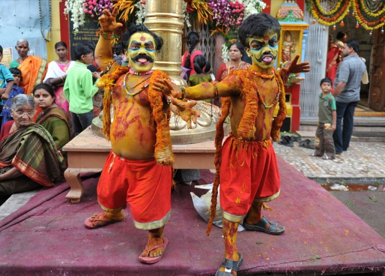 <p>Indian dwarf artists Ashok and Vinay dressed up as Potharaju, the brother of Hindu Goddess of power.</p>