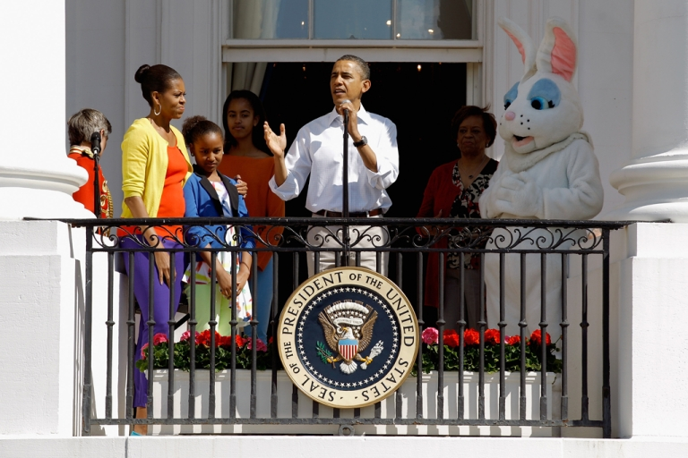 <p>Obama (C) speaks to participants along with (L-R) first lady Michelle Obama, daughters Sasha and Malia, and the Easter Bunny.</p>