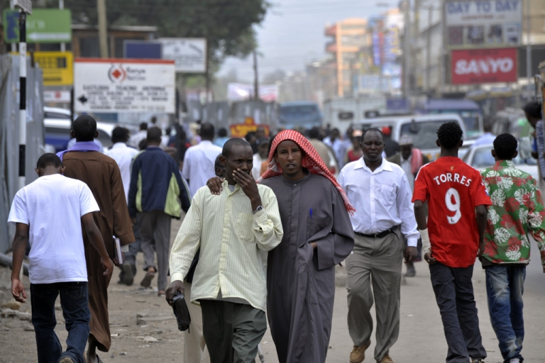 <p>Residents walk through Eastleigh, a neighborhood of Nairobi known for its Somali population, walk on January 18, 2010. Kenyan police detained 300 illegal Somali immigrants during a sweep that followed a deadly protest at Nairobi's main mosque. The raid on Eastleigh neighbourhood was carried out by the elite General Service Unit and the anti-terrorism police unit following allegations by the government that Somalia's hardline Al Shabaab group infiltrated the demonstration.</p>