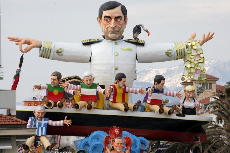 <p>A carnival float called 'But, where is the crisis?' shows the head of the European Central Bank Mario Draghi (top) and European leaders during the carnival parade in Viareggio, Italy on Feb. 5, 2012.</p>
