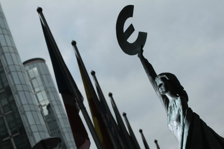 <p>The 'Europe' sculpture of Belgian artist May Claerhout shows a woman holding up the symbol of the Euro.  The euro is not doing well after ECB cut their interest rates.</p>