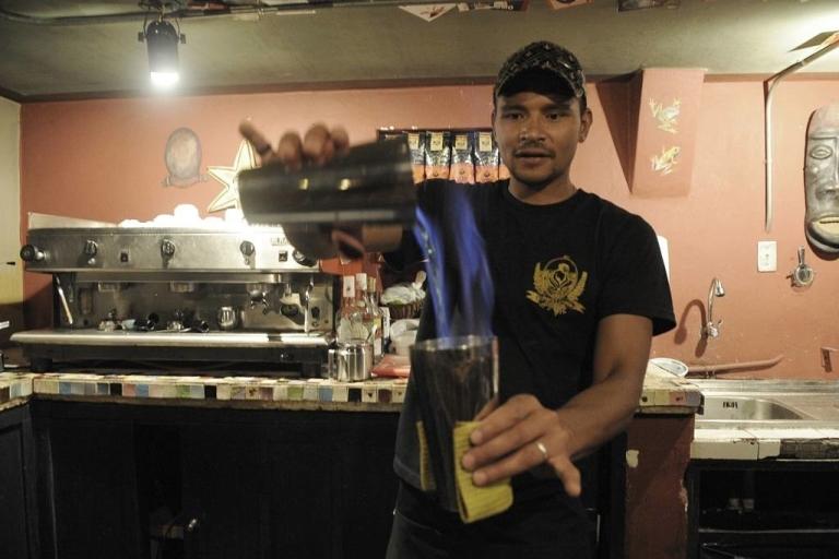 <p>A barman prepares a cocktail at Pobre Diablo, a traditional bar, restaurant and concert hall in Quito, Ecuador.</p>