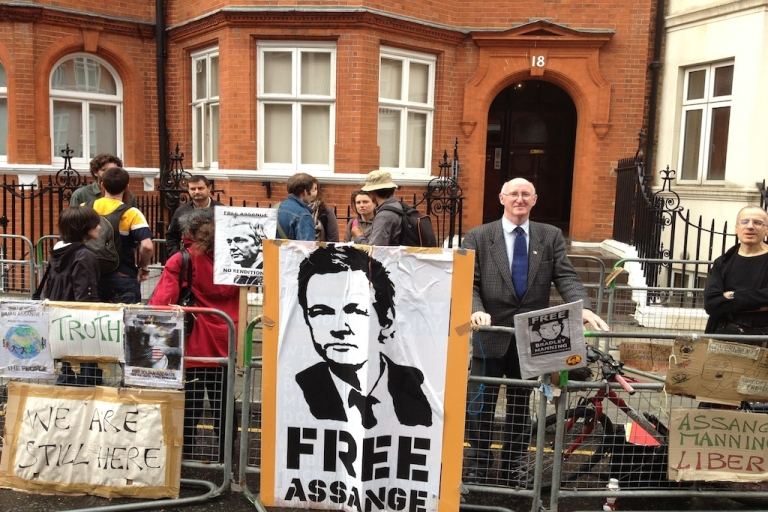 <p>Protesters and Assange supporters stand outside London's Ecuadorian embassy. The Wikileaks founder remains inside awaiting a decision on his plea for asylum.</p>