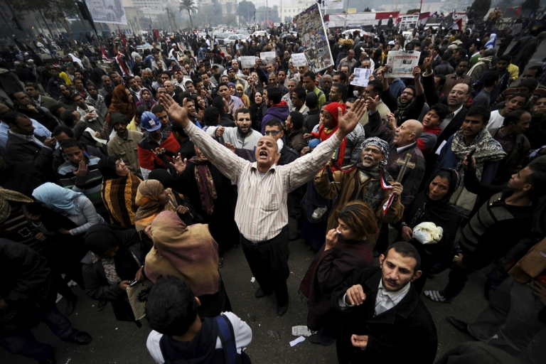 <p>Egyptian protesters chant slogans during a demonstration in Cairo's Tahrir Square in Dec. 2011. What will happen on the first anniversary of Egypt's uprising next week is anybody's guess.</p>
