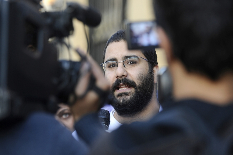 <p>Egyptian blogger and activist Alaa Abdel Fattah speaks to the press following his release from the police headquarters in Cairo in December. In a new report, Reporters Without Borders says Egypt is on its way to becoming an