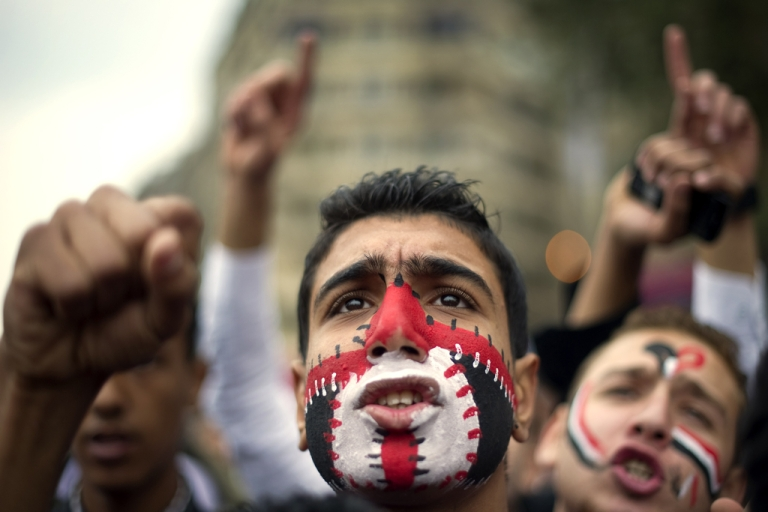 <p>An Egyptian anti-regime protester shouts slogans during a demonstration calling for the interim military rulers to step down in Tahrir Square in Cairo, Egypt. Reports that jailed blogger Maikel Nabil would be released ahead of the one-year anniversary of Egypt's uprising had raised hopes for protestors.</p>