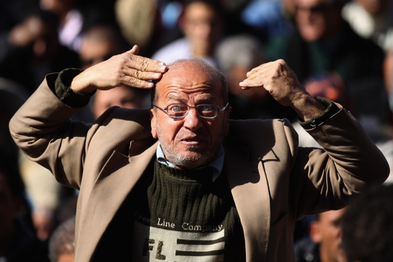 <p>An Egyptian man reacts in Tarhrir Square during Friday prayers on Jan. 27, 2012 in Cairo, Egypt. People prayed in the square just days after the tens of thousands celebrated in Cairo's Tahrir Square marking the first anniversary of the uprising which toppled President Hosni Mubarak.</p>