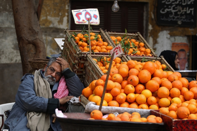 <p>A man sells oranges in the Magra El-Oyoun market on Jan. 24, 2012 in Cairo, Egypt. The country is struggling with falling tourism figures and rising unemployment following last year's revolution, which ousted President Hosni Mubarak.</p>