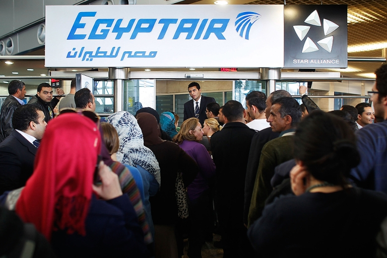 <p>An EgyptAir worker attempts to manage a huge crowd of people looking for flights out of Egypt at Cairo International Airport on January 31, 2011 in Cairo, Egypt.</p>