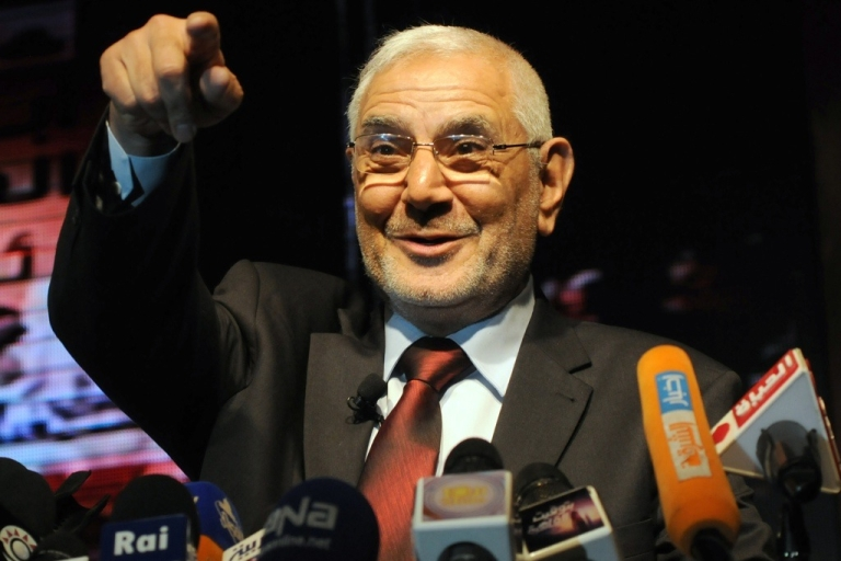 <p>Egyptian former Muslim Brotherhood member and now presidential candidate Abdelmoneim Abul Fotouh gestures to the crowd on stage during an election campaign rally on April 2, 2012, in Cairo.</p>